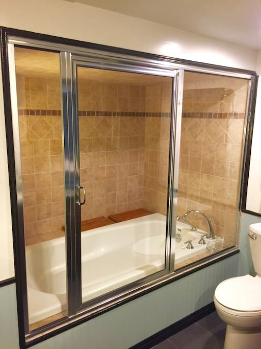 Relax and unwind in the steam room tub.