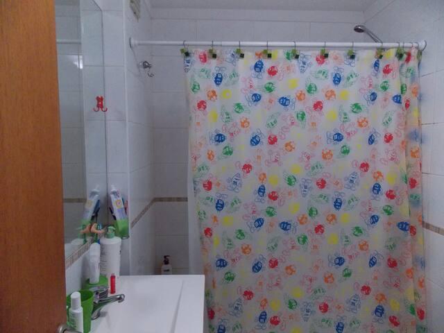 Bathtub and shower.