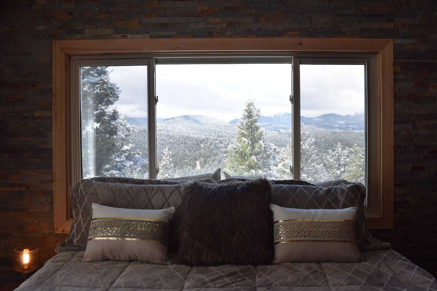 The king size bed sits in front of a picture window...with an amazing view!