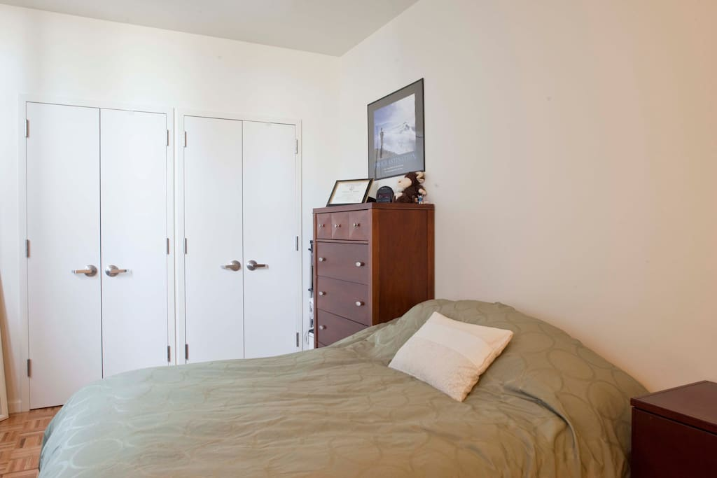 Bedroom features pillow-top queen bed and shiatsu massage chair