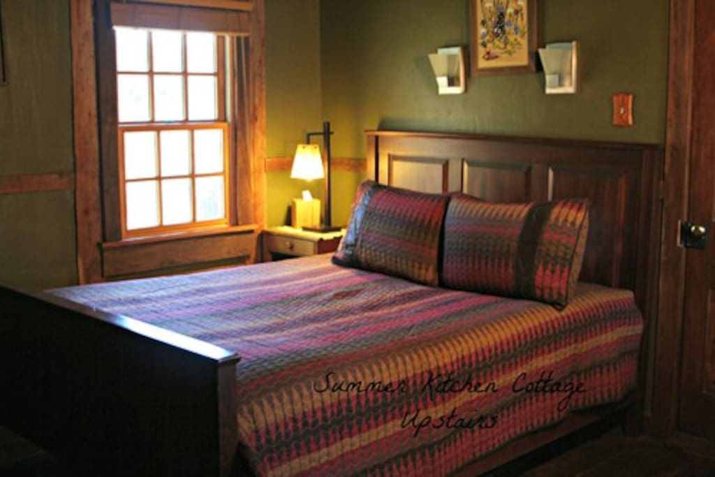 Upstairs bedroom with queen bed and bathroom