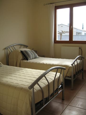 The spacious twin bedroom with two single beds