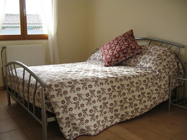 Bedroom two with a comfortable double bed and soft, warm linen