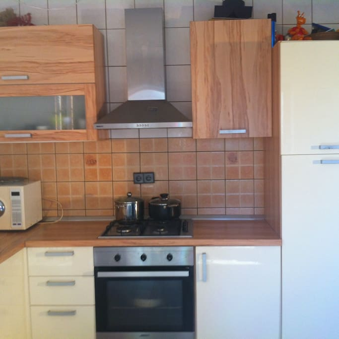 The fresh modern kitchen is fully equipped with microwave oven, coffee maker and hot water pot for easy preparation.