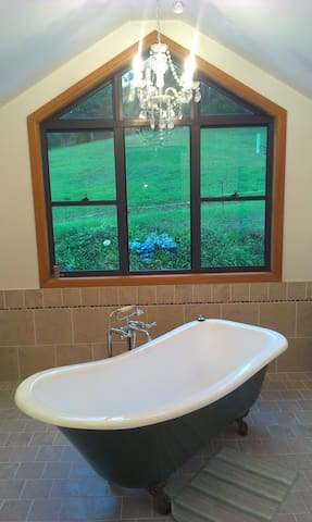 Spacious Bathroom, with Crows Foot Bath & telephone style shower.