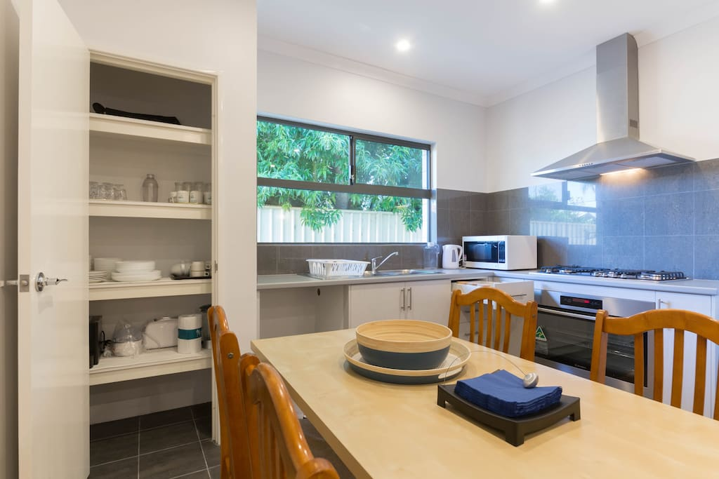 Spacious Pantry and Tableware Available For Use