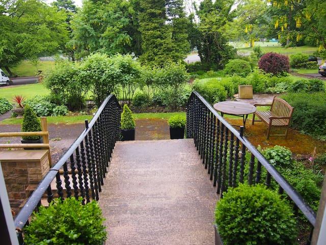 Communal gardens, Tennis courts and Cricket ground.
