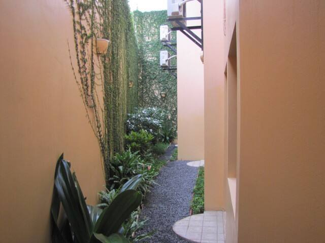Semi private area behind apartment.