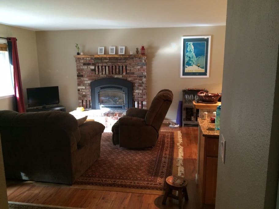 Living room has a cozy gas fireplace