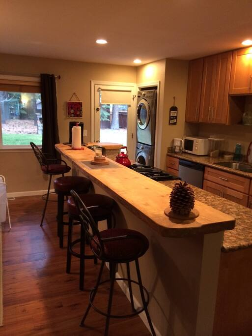 Open kitchen with huge breakfast bar and laundry