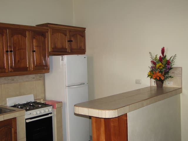 Full kitchen with frost free refrigerator and 4 burner stove and oven.