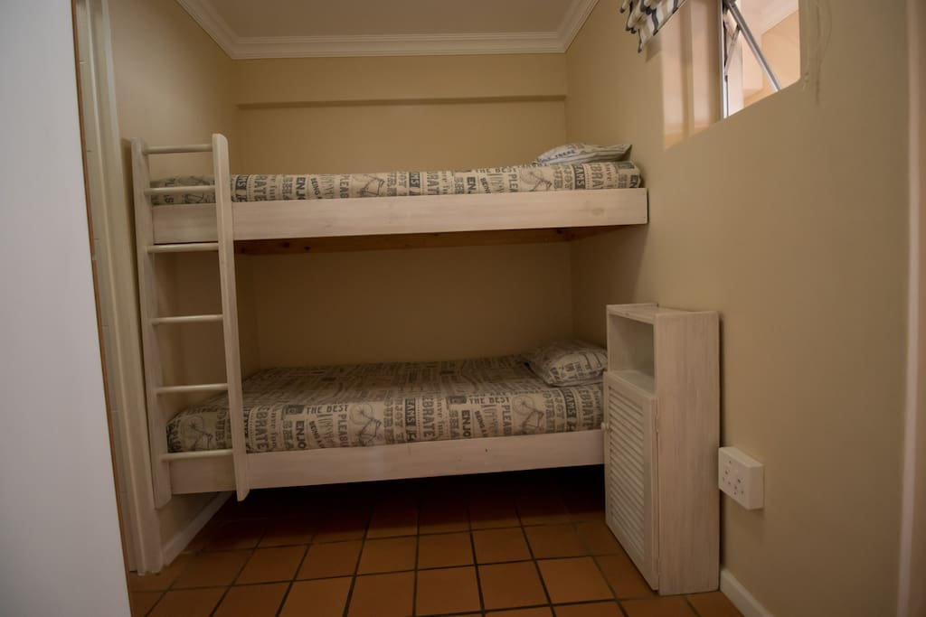 Bedroom 2 with 2 single beds on bottom floor.
