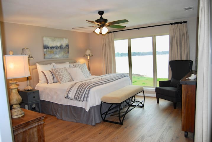Master bedroom with beautiful view of lake, ensuite bathroom and TV.