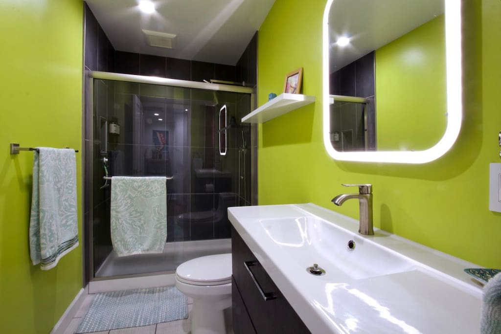 Newly remodeled bathroom with rain shower along with complimentary shampoo, conditioner and body wash.