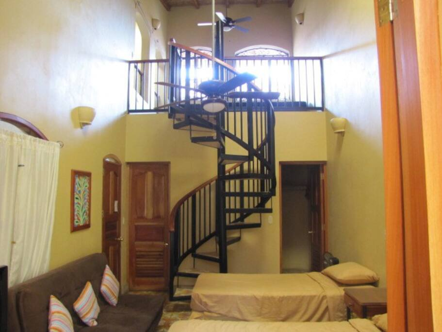 Walk in closet on right and stairway to upper floor.  It also has a futon or sleeper sofa