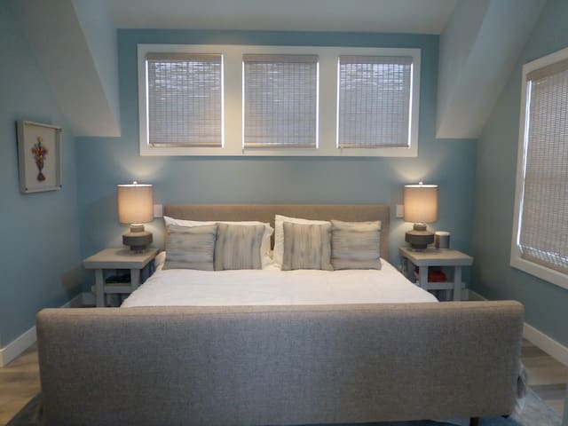 Luxurious master bedroom: king bed, sonos system, television, access to top deck.