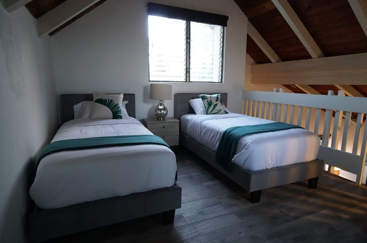 Two twin beds in the loft area