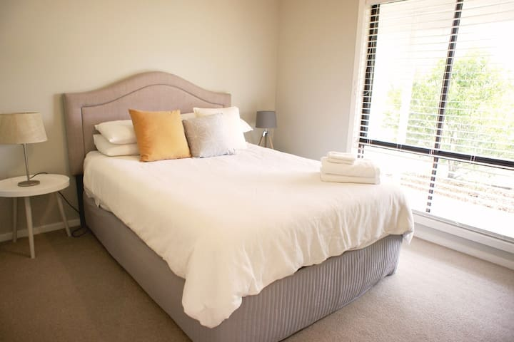 Main bed room with super comfortable queen size ensemble, bedside tables and lamps, electric blanket and build in robe