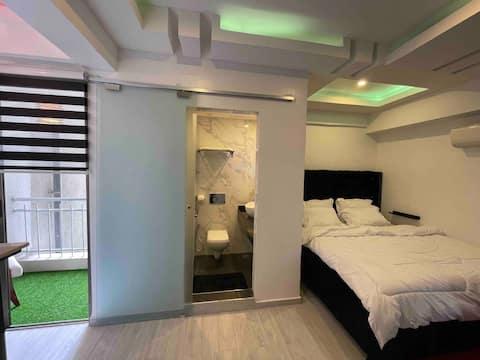 Cozy, Modern & lavish 1-bedroom service apartment