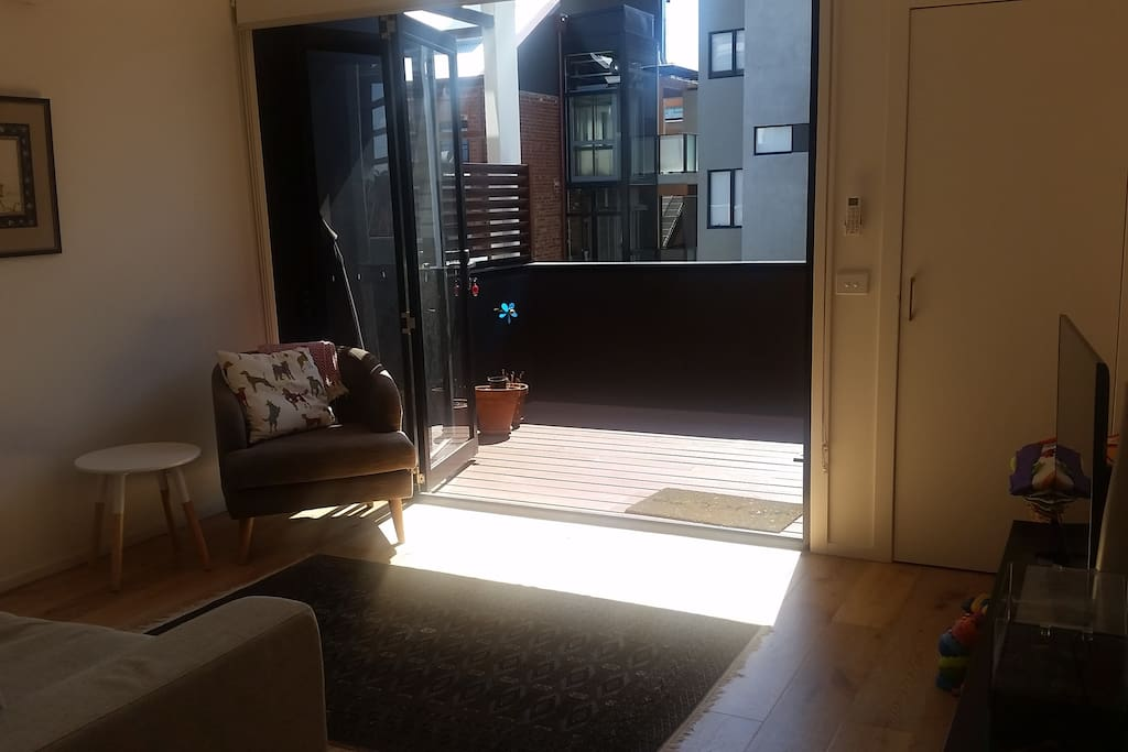 lounge opening onto a sun drenched deck