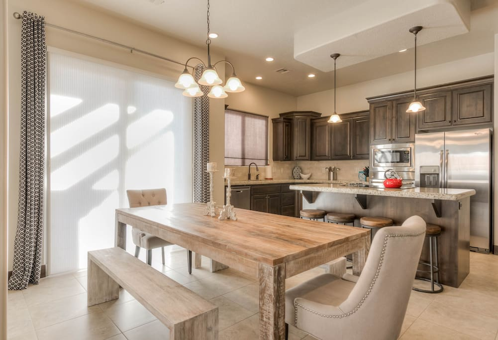 Open kitchen concept with plenty of dining seating