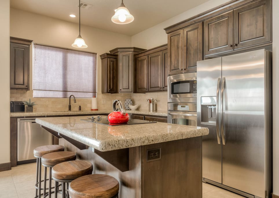 Beautiful stainless appliances with fully stocked kitchen