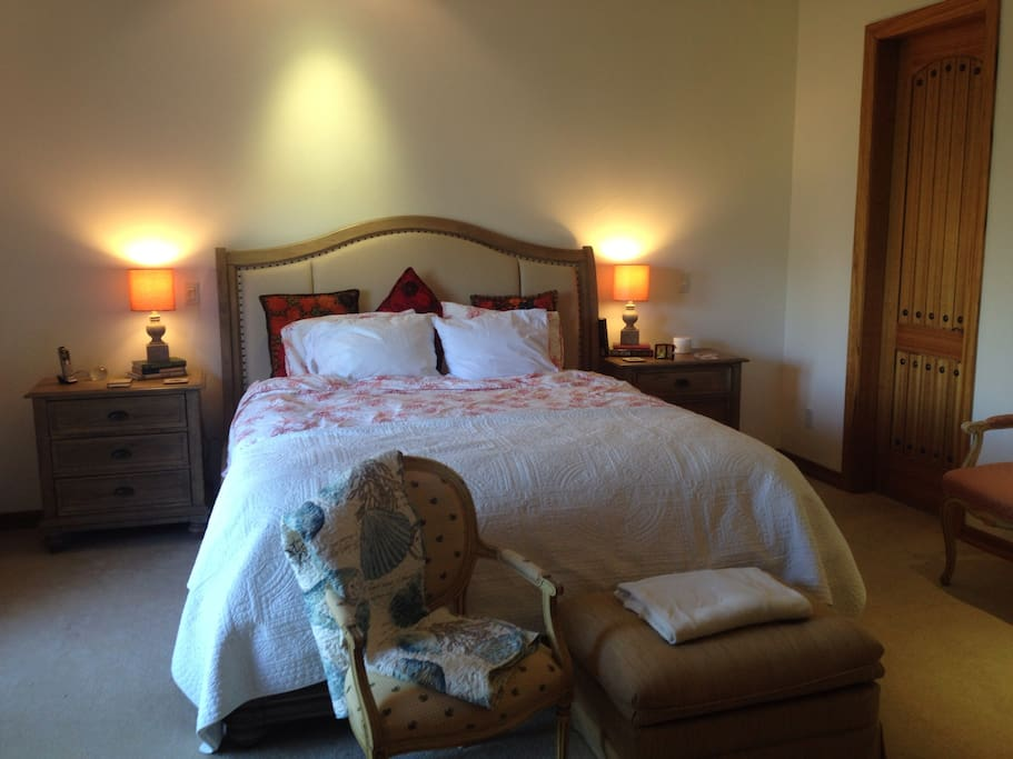 Master bedroom with king size bed, flatscreen, fireplace and French doors that look onto the golf course.