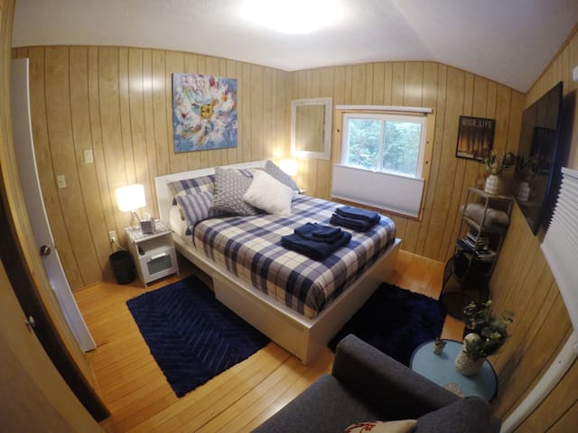 """Bedroom with queen size bed and 55"""" HDTV: Netflix and Prime Video (Amazon)."""