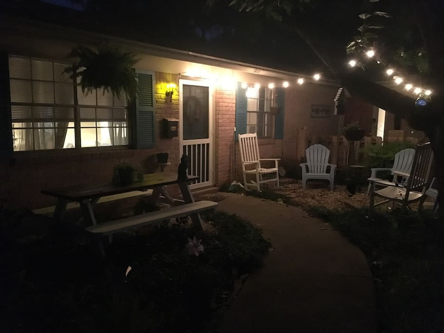 Night view! Our front yard outside area complete with seating and a picnic table to enjoy the view of downtown!