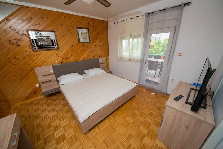 Bedroom with king size bed and bathroom