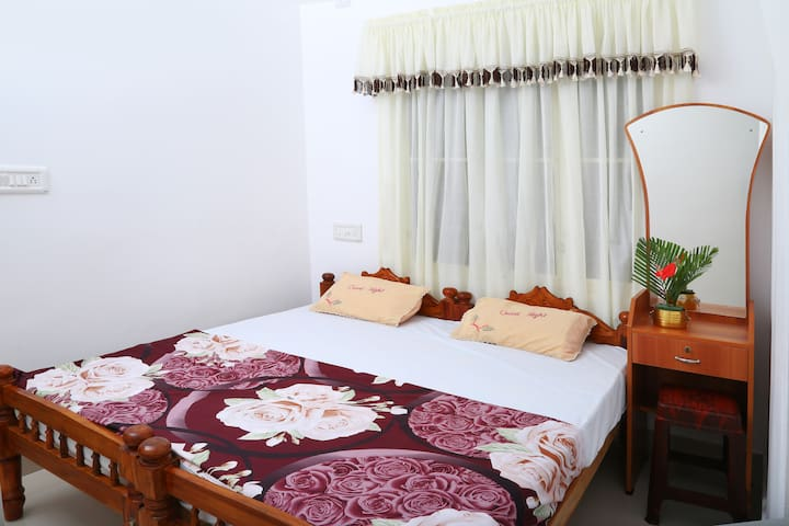 One of our three guest rooms- Queen size bed, can be split into two single beds for guests
