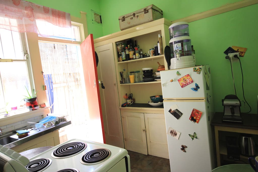 the little cute kitchen with access to garden and bbq
