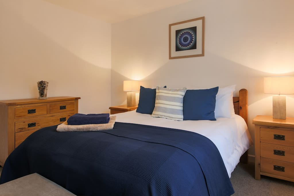 Both Kingsize beds are solid oak with matching furniture, 100% cotton linen and blackout blinds.