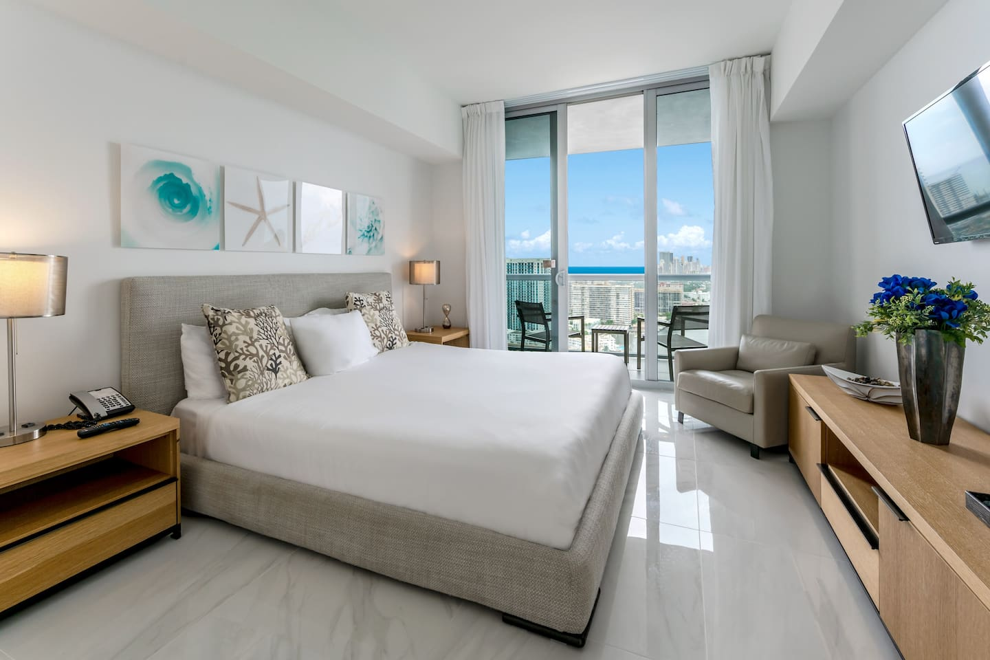 Luxurious One Bedroom Apartment with King size bed and marble floors. Master Bedroom includes LED TV, marble floor balcony and walk-in closet.