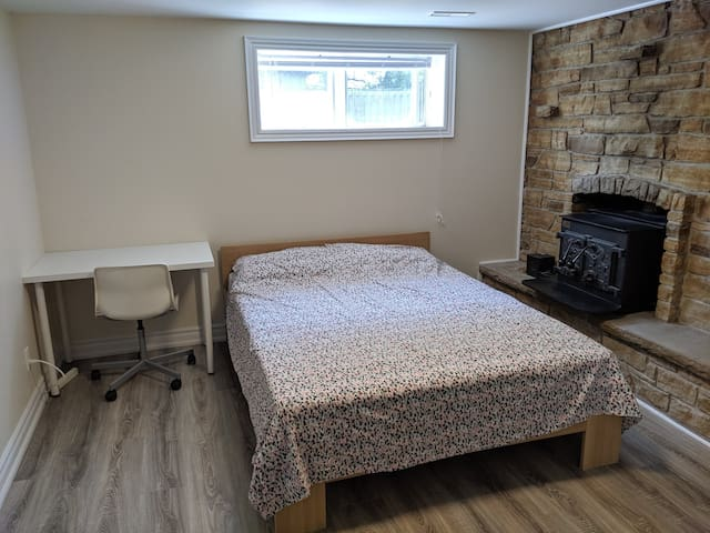Bright and clean private bedroom in basement unit