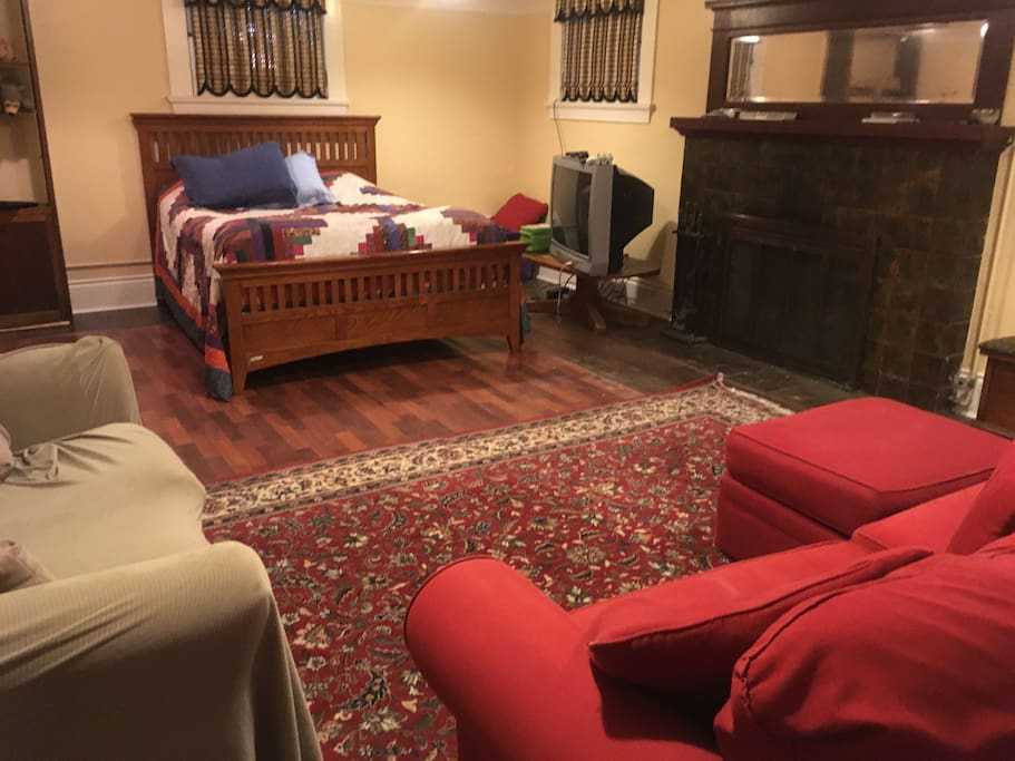 The large one room apartment has a queen bed, double futon