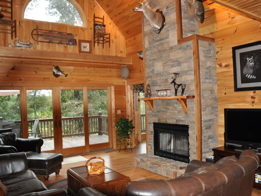 Spacious living room with stone fireplace and cathedral ceilings!