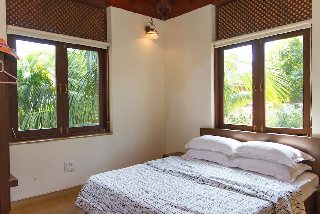 bedroom 2 on upper level with private patio