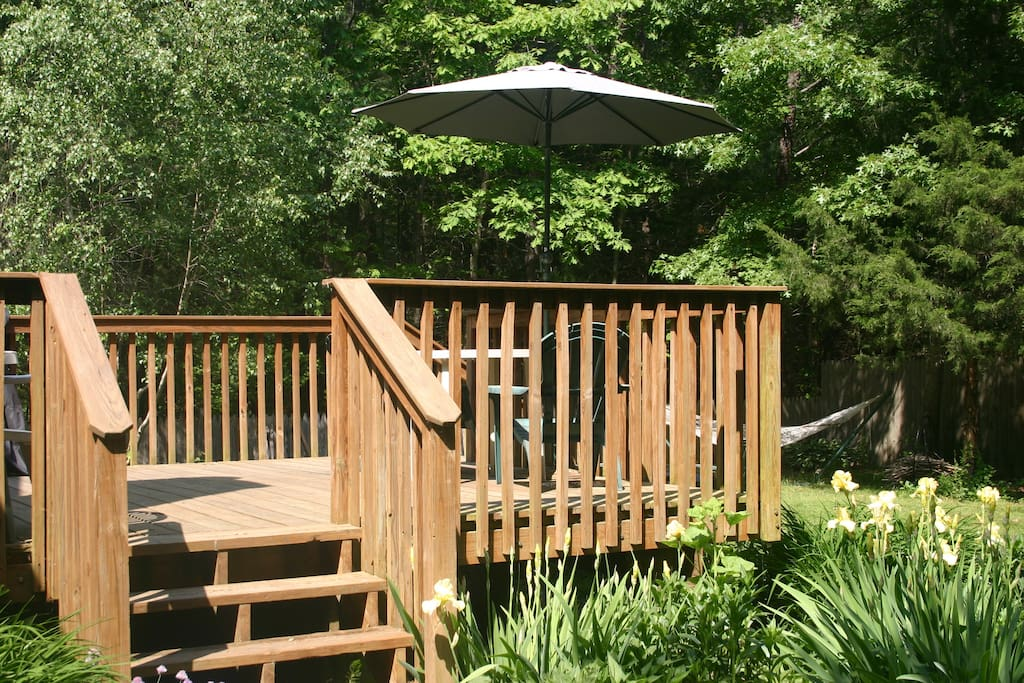 Have your first cup of coffee out on the deck overlooking the backyard.