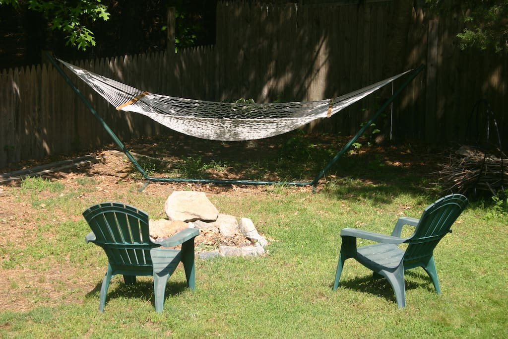 A shady hammock awaits and the fire pit for evening campfires.