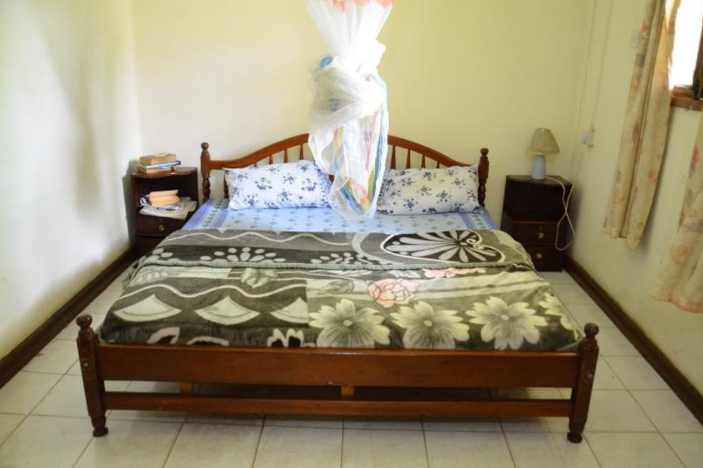Bedroom with mosquito net. If you prefer two single beds we can arrange that.