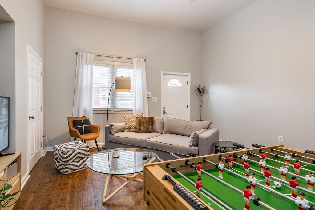 Yes, that's a Foosball table in the living room.  Would it be the Fun House if it wasn't?  Nope.