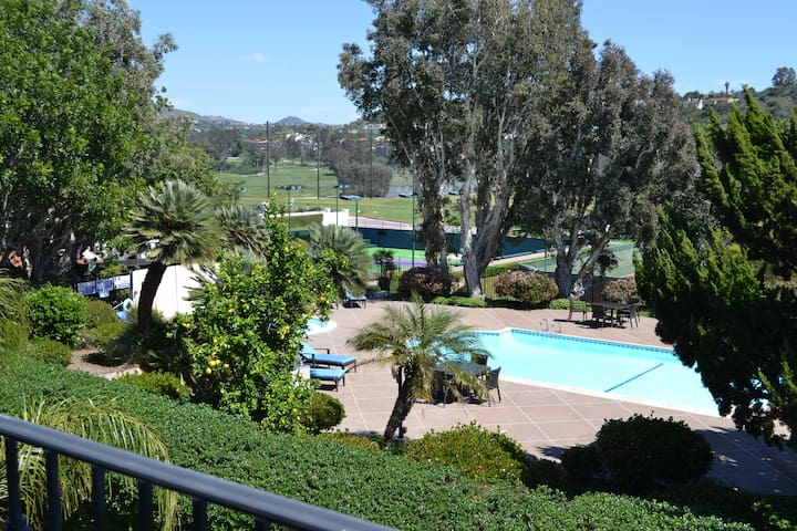 Balcony with view over the pool/spa and golf course, plus tennis court views