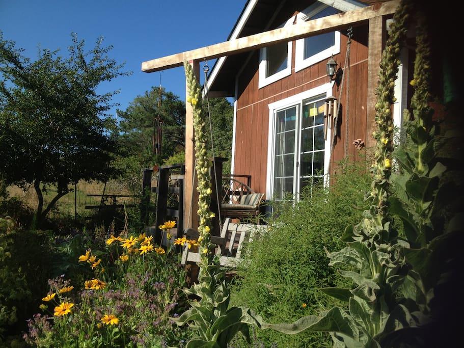 deck and swing overlooking garden