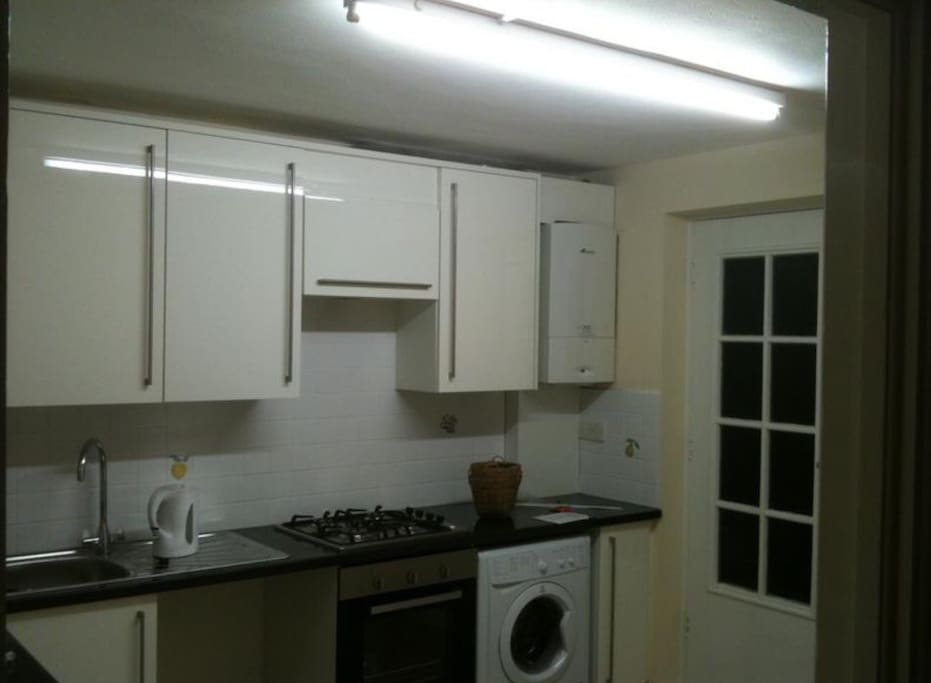 Shared access to kitchen with fridge, washing machine and dish washer.