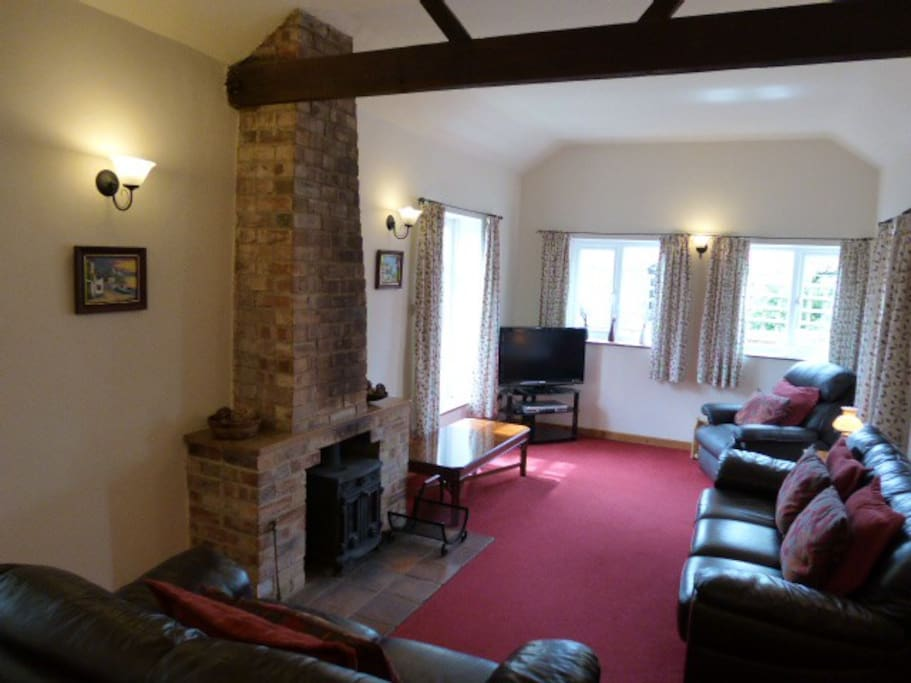 Vaulted lounge with wood-burner
