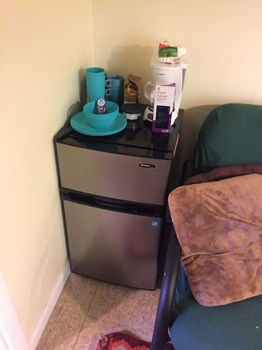 Mini fridge and freezer, dishes, coffee machine, and complimentary Good Day Chocolates!