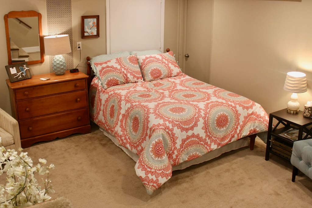 double bed, dresser available for your clothes (additional blankets available in bottom drawer), alarm clock