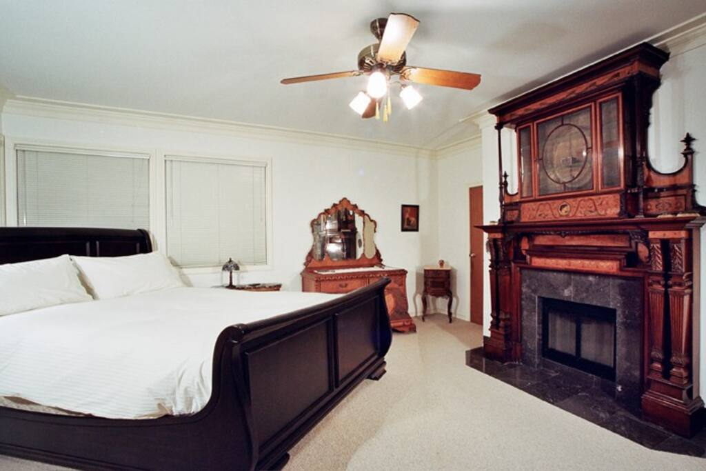 Furnished with exquisite antiques one of the most memorable pieces in the house is the 10' inlaid wooden fireplace mantle