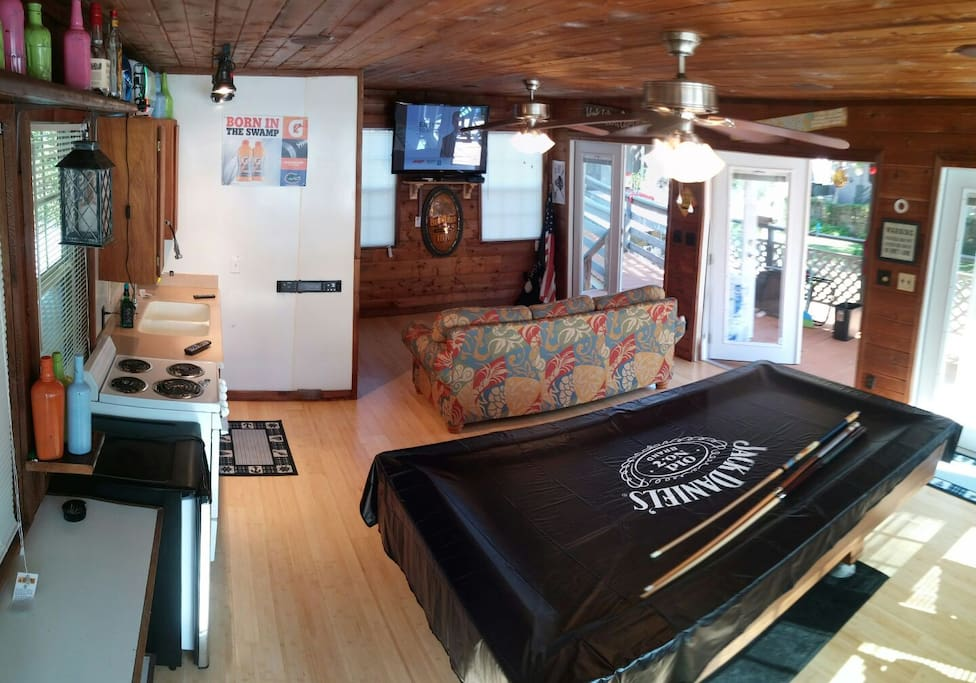 Game room with surround sound, satellite, heat and ac. Kitchen bathroom and pullout couch.